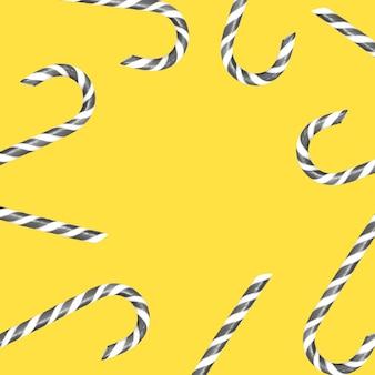 Szare i białe cukierki świąteczne na żółtym tle z miejsca na kopię. kolory roku 2021.