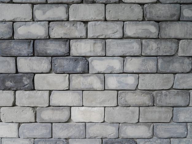 Szare kwadratowe ceglane płytki ścienne tekstury tła, minimalne tło zewnętrzne
