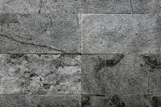 Szare marmurowe płytki teksturowane w tle