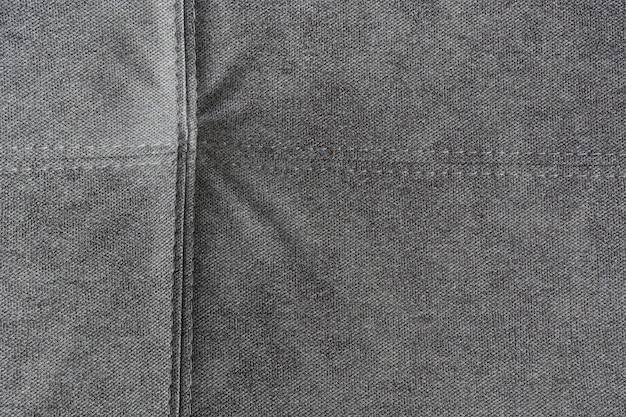 Szare miękkie ze wzorem szwów. tekstura, abstrakcyjne tło. powierzchnia. ścieśniać