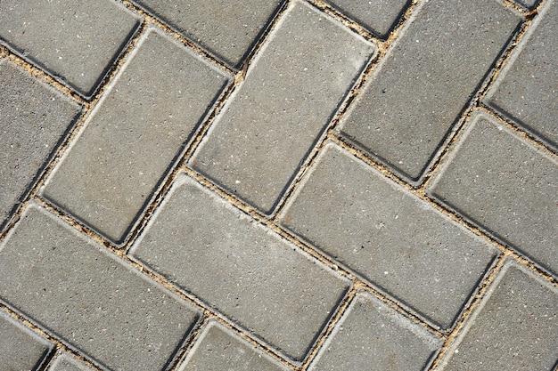 Szare płytki chodnikowe dla tła lub tekstury