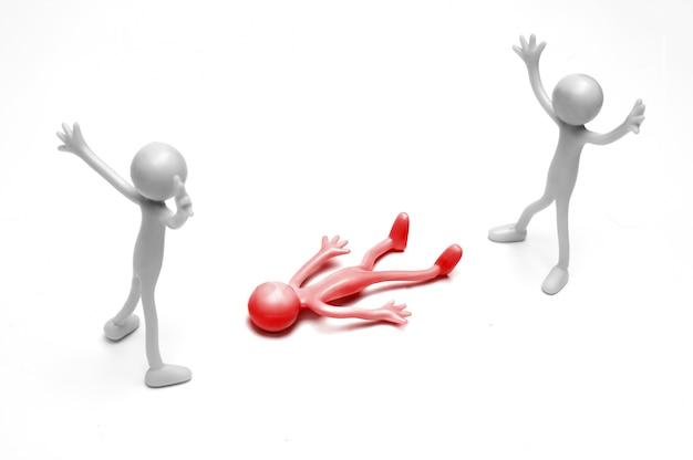 Szare szmaciane lalki patrząc czerwony rag doll leżącego