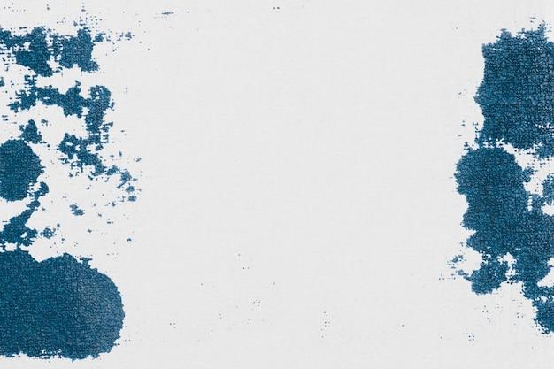 Szare tło obramowania z niebieską plamą z tkaniny