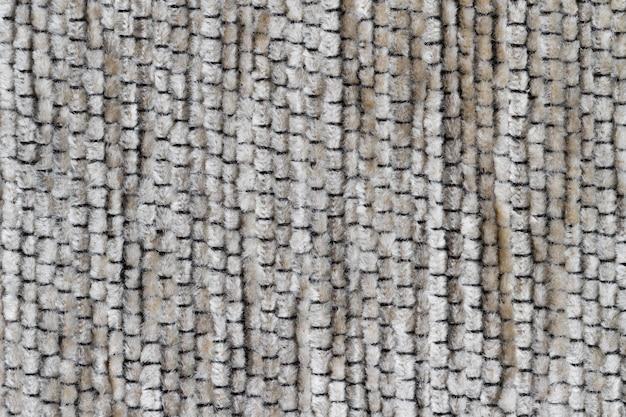 Szaro-brązowa sztuczna faktura futra jako kompozycja tła.