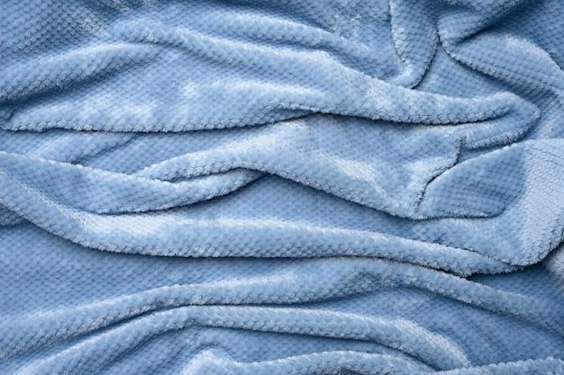 Szaro-niebieski plusz, pomarszczone płótno, zbliżenie