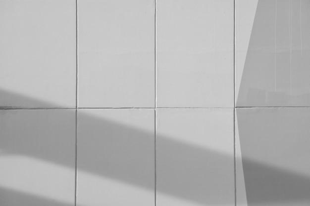 Szarość cementu ściana z linią i cieniem