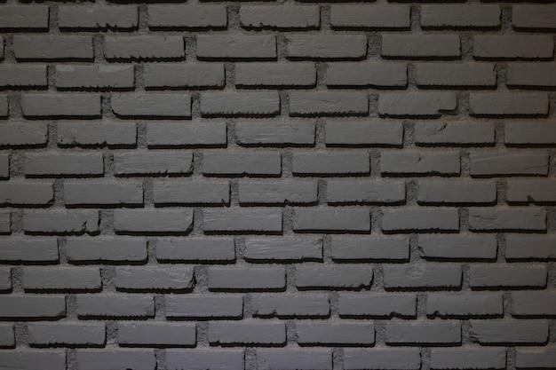 Szarość koloru ściana z cegieł dla tła