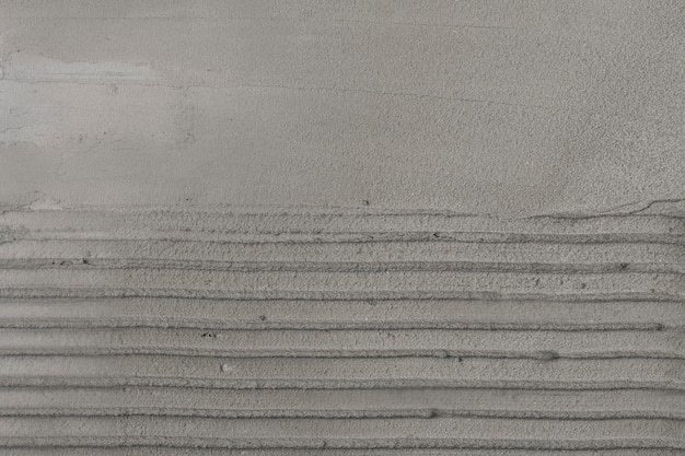 Szary beton w paski teksturowane tło