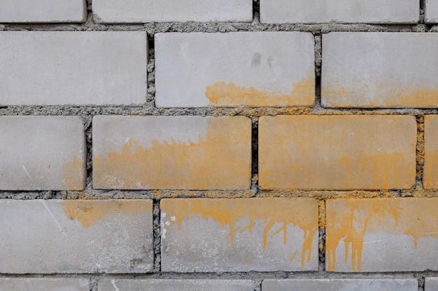 Szary ceglany mur tło