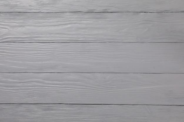 Szary drewniany. tekstura dla twojego projektu. miejsce na tekst