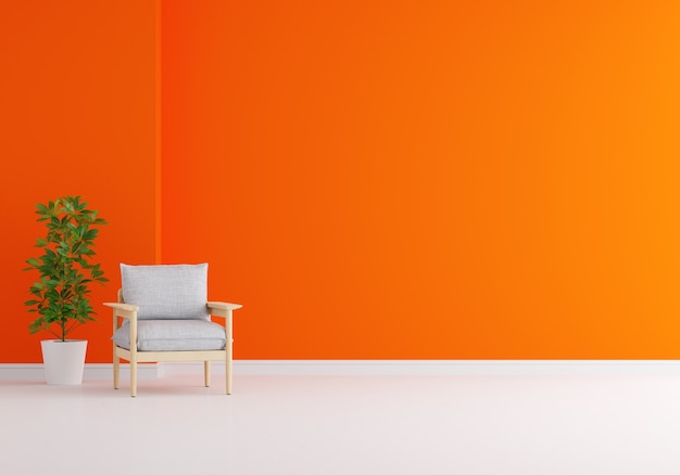 Szary fotel w pomarańczowym salonie z miejscem na kopię