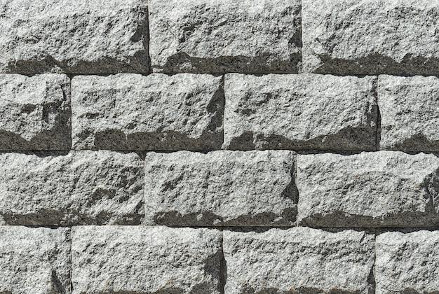 Szary granitowy mur z bliska tła i tekstury