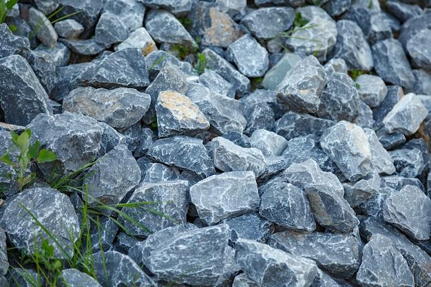 Szary kamień tekstura tło. tekstura kamień twarz