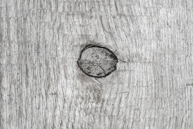 Szary kolor tła starego drewna z węzłem struktury. close-up makro widok naturalnej starożytnej tekstury drewna, drewniany wzór.