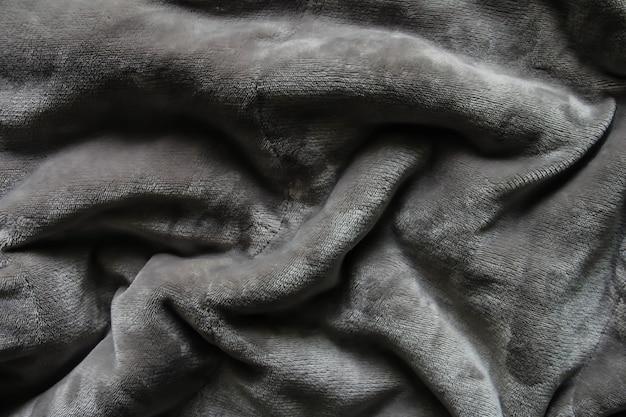 Szary kudłaty koc tekstury jako tło fluffy fałszywe futro włókienniczych nieostrość selective focus