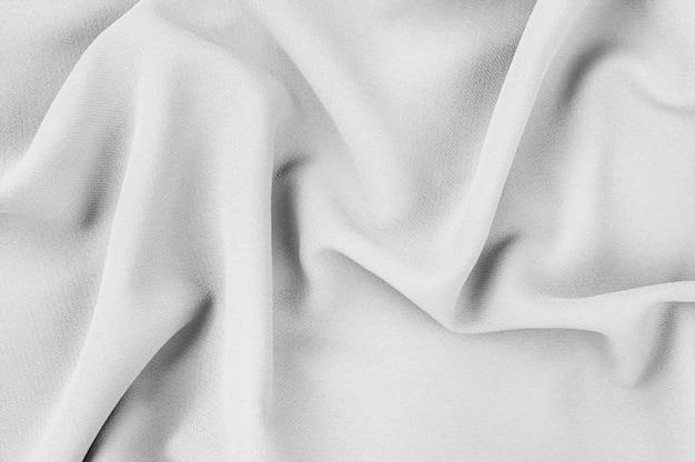 Szary materiał żakardowy o naturalnej fakturze. monochromatyczna tekstura, tło wzór.
