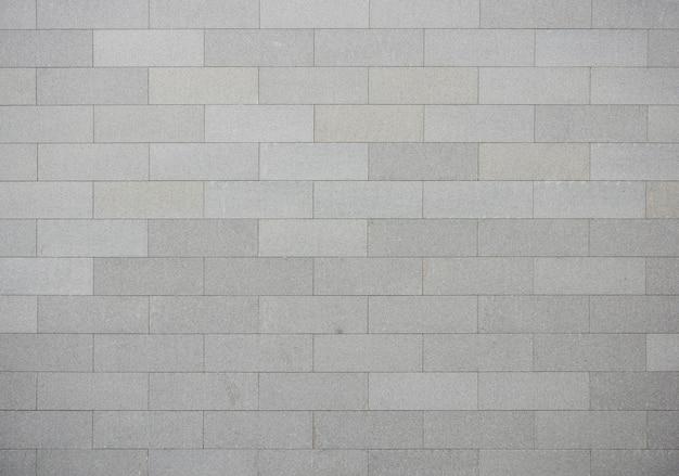 Szary mur z cegły