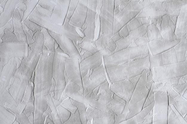 Szary rowkowany stiuk na ścianie. tynk wzorzyste tekstury lub tła. zbliżenie