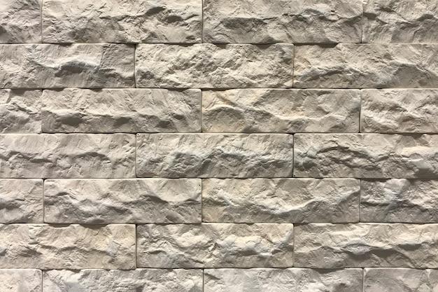 Szary ściana z cegieł tekstury tło. wyłożone kafelkami z przestrzenią konopną
