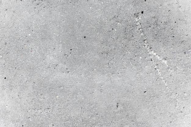 Szarym tle ściany cementowe
