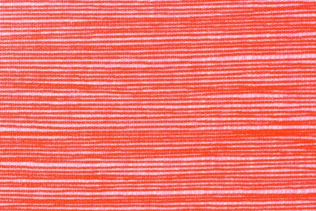 Szczegół na pomarańczowym tkaniny tle
