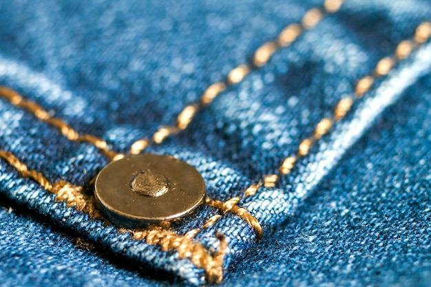 Szczegół niebieskich dżinsów zamknięty up