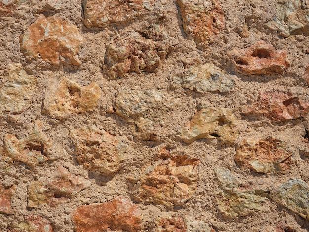 Szczegół śródziemnomorskiej kamiennej ściany ręcznie wykonanej
