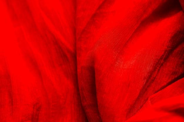 Szczegół tekstura czerwona tkanina w kolorze