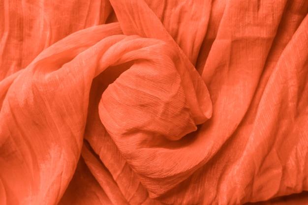 Szczegół tekstura pomarańczowa tkanina w kolorze