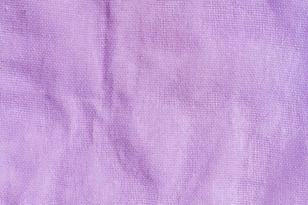 Szczegół tekstura purpurowa tkanina w kolorze