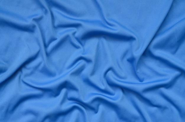 Szczegółowa tekstura tkanina poliestrowa niebieska z wieloma fałdami