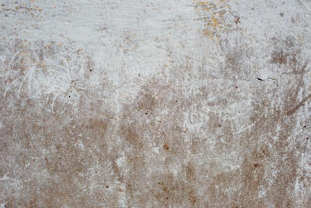 Szczegóły brudnej popękanej betonowej ścianie. skopiuj miejsce