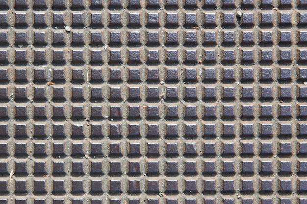 Szczegóły starego kwadratowego tła metalowego wzoru