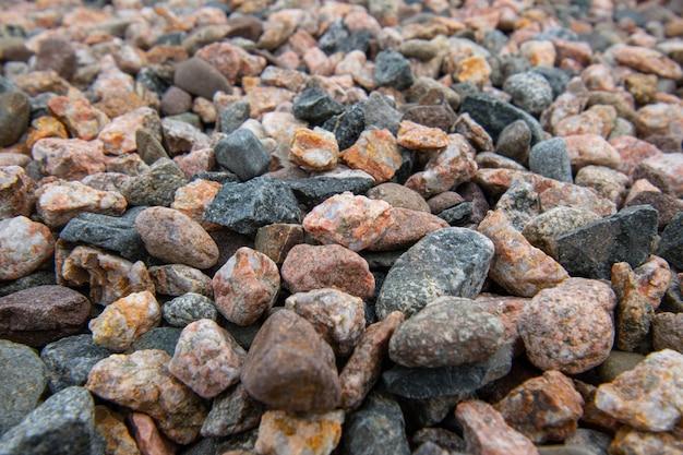 Szczegóły tekstury bordowo-beżowego marmuru