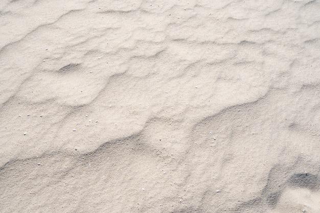 Szczegóły tekstury piasku w tropikalnej wyspie lato w tle i projekt podróży.