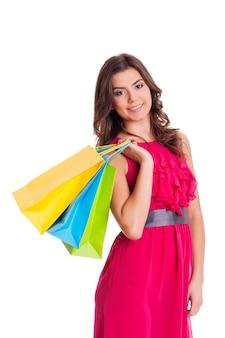 Szczęśliwa kobieta trzyma jej torby na zakupy