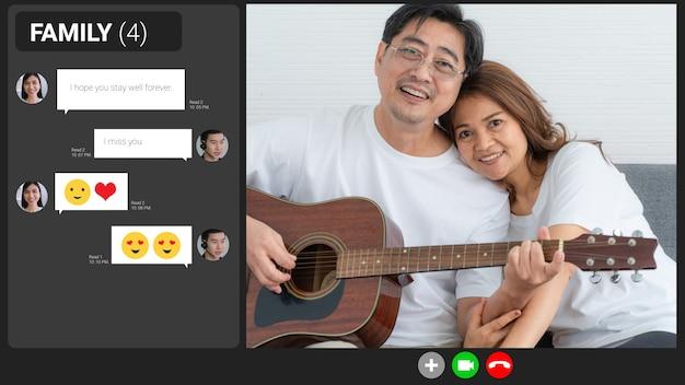 Szczęśliwa rodzina rozmawia przez internet wideorozmowę w domu