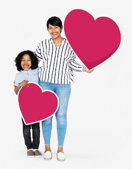 Szczęśliwe matki i syna mienia serca ikony