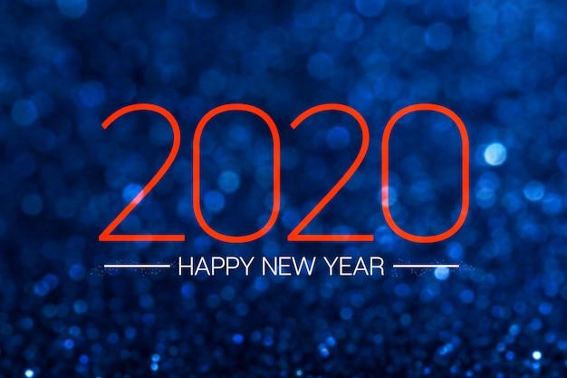 Szczęśliwego nowego roku 2020 z ciemnoniebieskimi brokatowymi błyszczącymi światłami bokeh