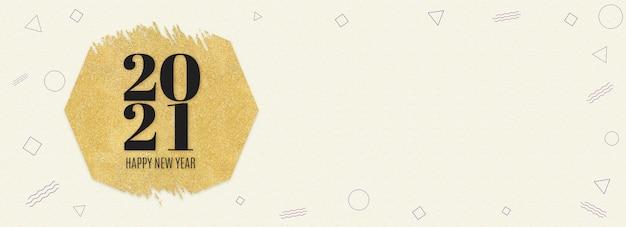 Szczęśliwego nowego roku 2021 słowo na złotym sześciokątnym brokacie na kremowym nowoczesnym wzorze geometrycznym