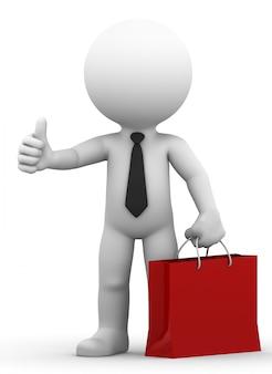 Szczęśliwy biznesmen posiadania torby na zakupy i daje kciuk w górę