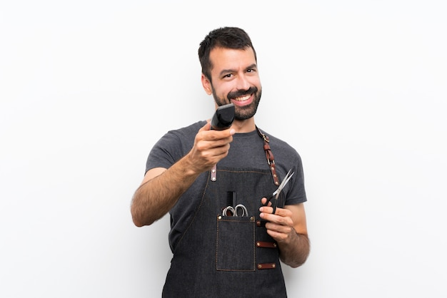 Szczęśliwy człowiek fryzjer w fartuch