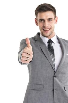 Szczęśliwy młody biznesmen z kciuki do góry znak na białym tle na białej powierzchni