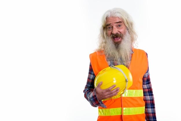 Szczęśliwy starszy brodaty mężczyzna robotnik budowlany