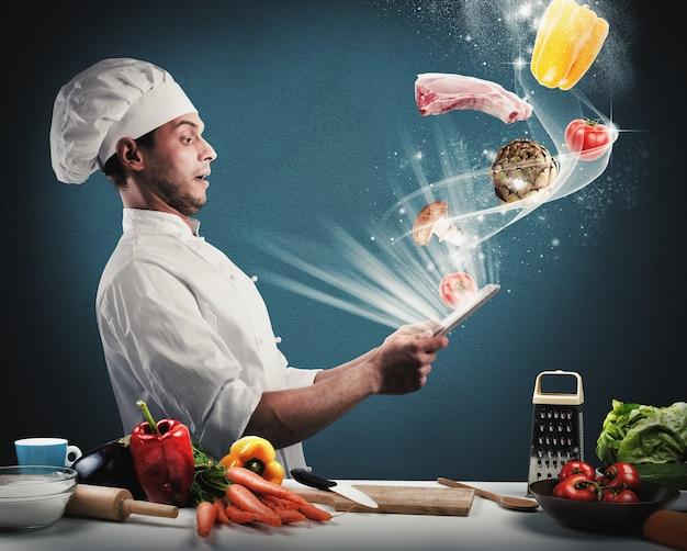 Szef Kuchni Czyta Przepis Na Jedzenie Z Tabletu Premium Zdjęcia