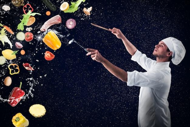 Szef Kuchni Tworzy Muzyczną Harmonię Z Jedzeniem I śniegiem Premium Zdjęcia