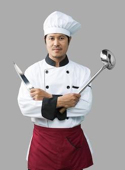 Szef kuchni z nożem i łyżką