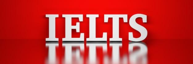 Szeroki baner z dużym pogrubionym białym słowem ielts na czerwonym tle ilustracji 3d