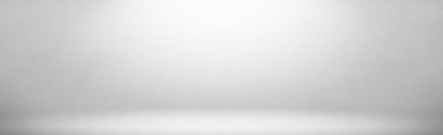 Szerokie białe szare gradienty pokoju studio jasnym tle