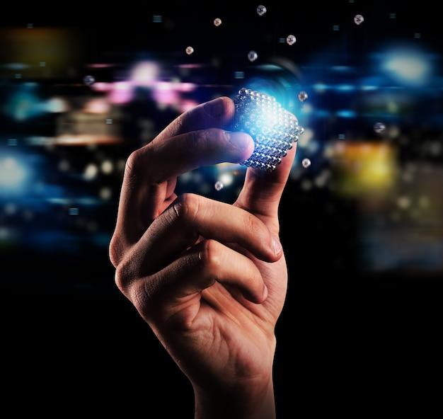 Sześcian magnetycznych kulek trzymanych w dłoni. pojęcie związku i partnerstwa